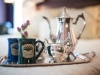 two mugs and silver coffee pot