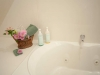 Jetted tub with a basket with pink flowers
