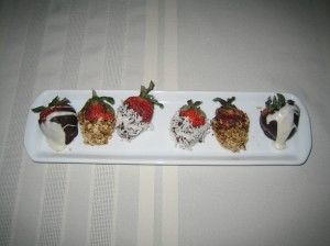 The beauty of luscious, hand dipped strawberries for your February stay with us